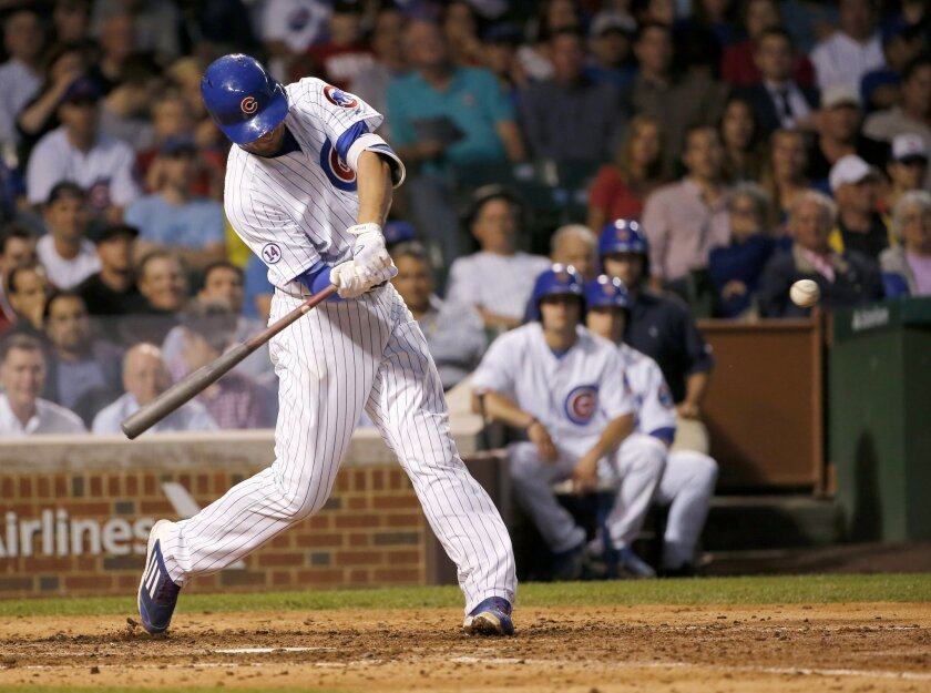 Chicago Cubs' Kris Bryant steps into his home run off Washington Nationals relief pitcher Aaron Barrett during the eighth inning of a baseball game Tuesday, May 26, 2015, in Chicago. (AP Photo/Charles Rex Arbogast)