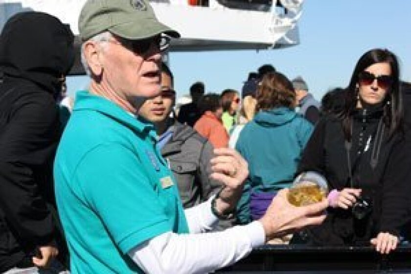 Birch docent Don Ward tells onlookers about how a whale uses its baleen system to filter the krill and other nutrients out of the mud for food The baleen is composed of keratiin — the same material in human hair and fingernails.