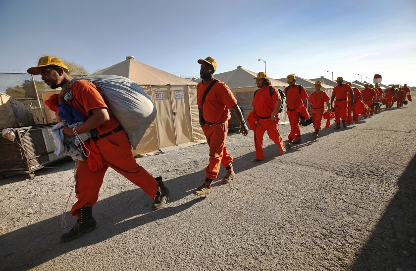 Inmates on a fire crew rest at camp after working on the Thomas fire in Ventura County on Dec. 12, 2017.