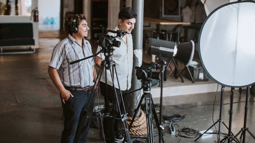 David's Harp Foundation program graduates Jesus Villegas, 22, left, and David Higareda, 21, have recently launched their own corporate video business thanks to engineering and production skills they learned at the East Village foundation as teens.