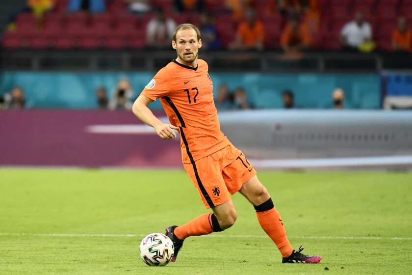 Daley Blind of the Netherlands controls the ball during the Euro 2020 soccer championship group C match between the Netherlands and Ukraine at the Johan Cruyff ArenA, Amsterdam, Netherlands, Sunday, June 13, 2021. (Piroschka van de Wouw/Pool via AP)