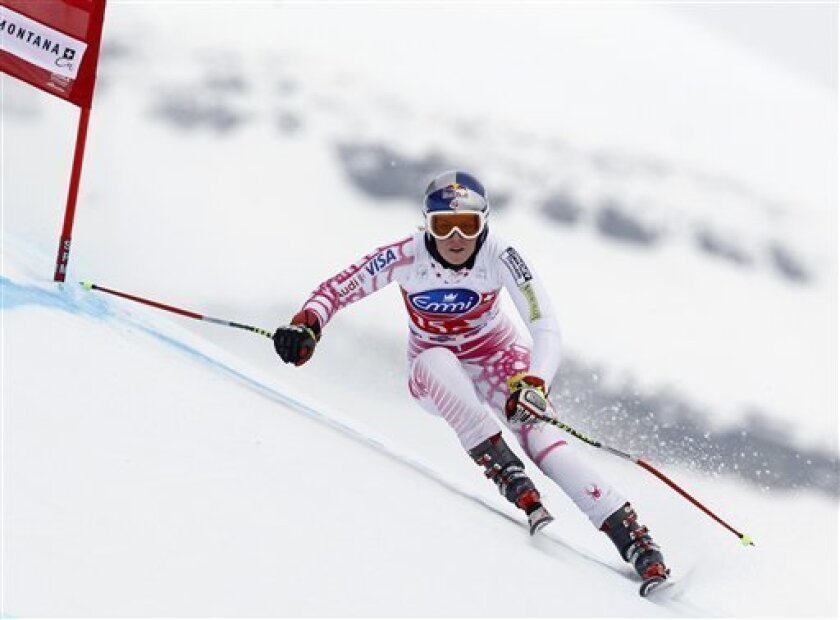 Lindsey Vonn, of the US, speeds down the course to set the third fastest time during practice for an alpine ski, Women's World Cup downhill, in Crans Montana, Switzerland, Thursday, March 4, 2010. (AP Photo/Marco Trovati)