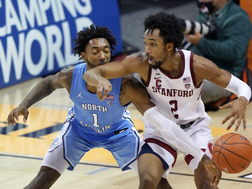 North Carolina guard Leaky Black knocks the ball away from Stanford guard Bryce Wills.