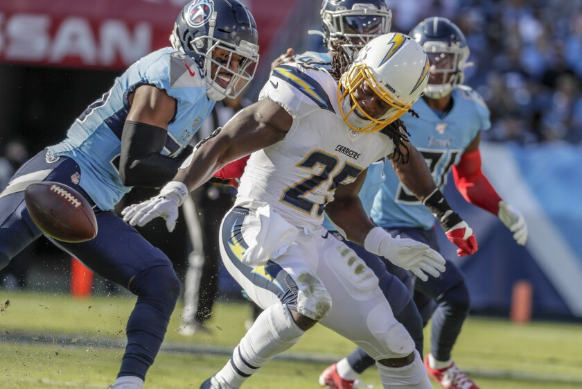 Chargers running back Melvin Gordon fumbles the ball before recovering it.