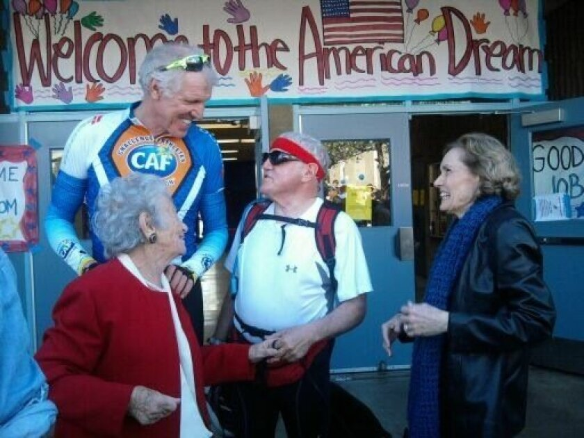 Holocaust survivor Gerda Weissmann Klein, retired NBA star Bill Walton and John and Diane Eckstein chat before the Eckstein's began a cross-country biking-and-walking trip to promote citizenship. Walton  rode with the group on Friday as they departed San Diego. Weissman Klein founded Citizenship Co