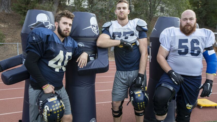 Patryk Guk, left, Kilian Zierer, center, and Philip Weinzierl are on the playoff bound with the College of the Canyons football team posing on the field during practice in Valencia on Thursday.
