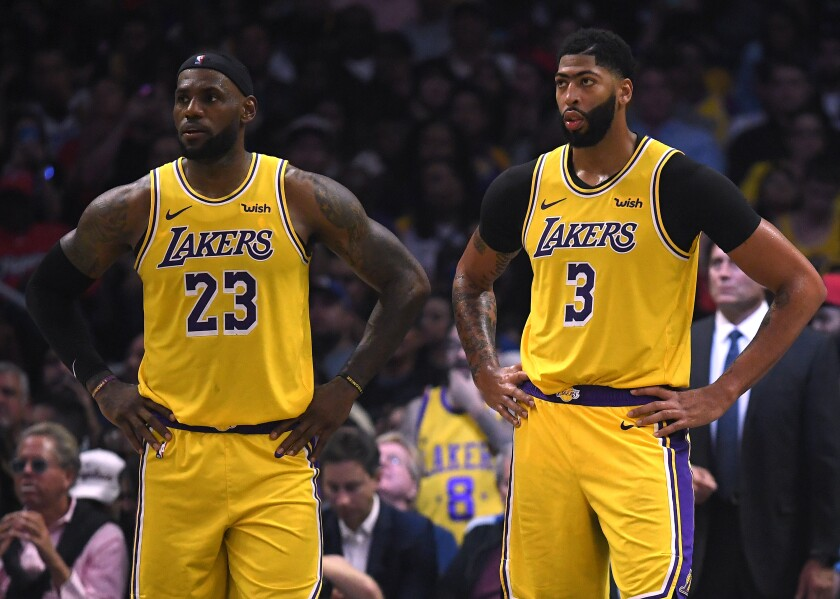 Lakers' LeBron James, left, and Anthony Davis react during a game at Staples Center.