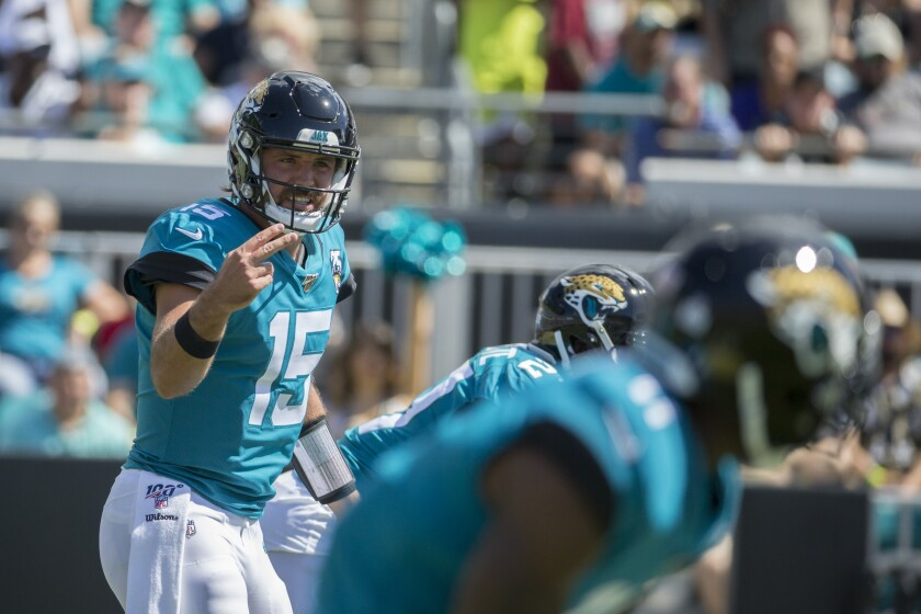 Jacksonville Jaguars quarterback Gardner Minshew (15) calls a play at the line of scrimmage against the New Orleans Saints during the first half on Sunday in Jacksonville, Fla.