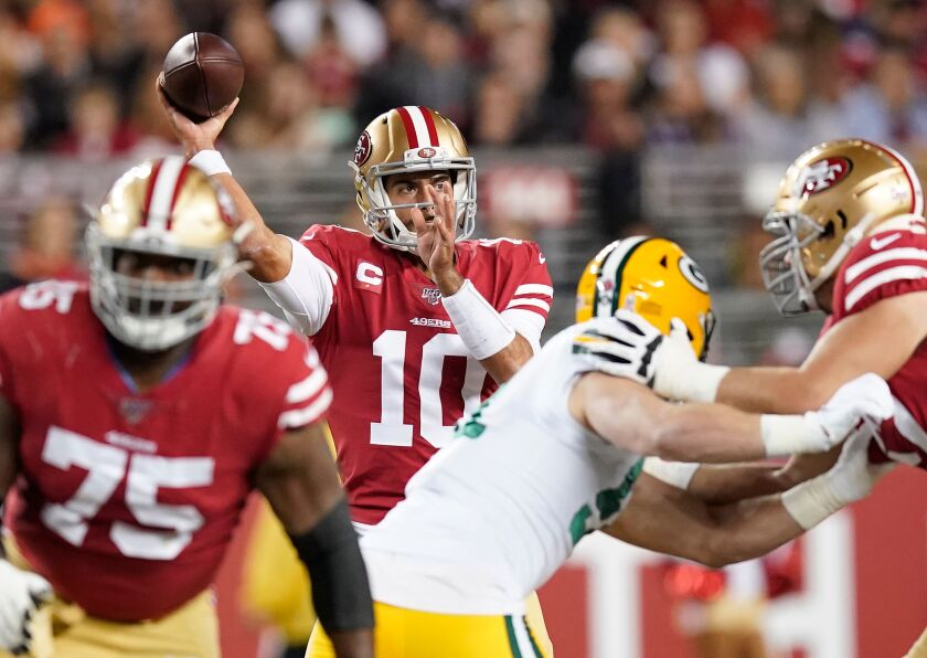 San Francisco 49ers quarterback Jimmy Garoppolo passes against the Green Bay Packers during the first half on Nov. 24, 2019 in Santa Clara.