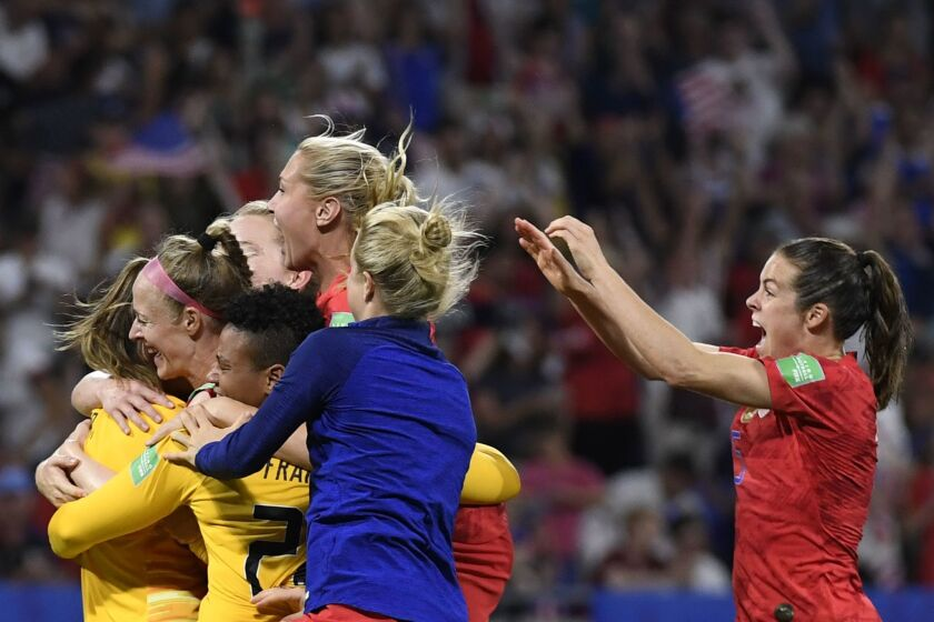 U.S. players celebrate at the end of the France 2019 Women's World Cup semi-final football match between England and USA.