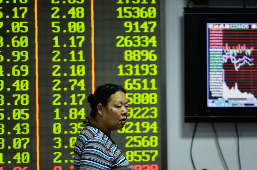 An investor observes trading at a stock exchange in Hangzhou, China.