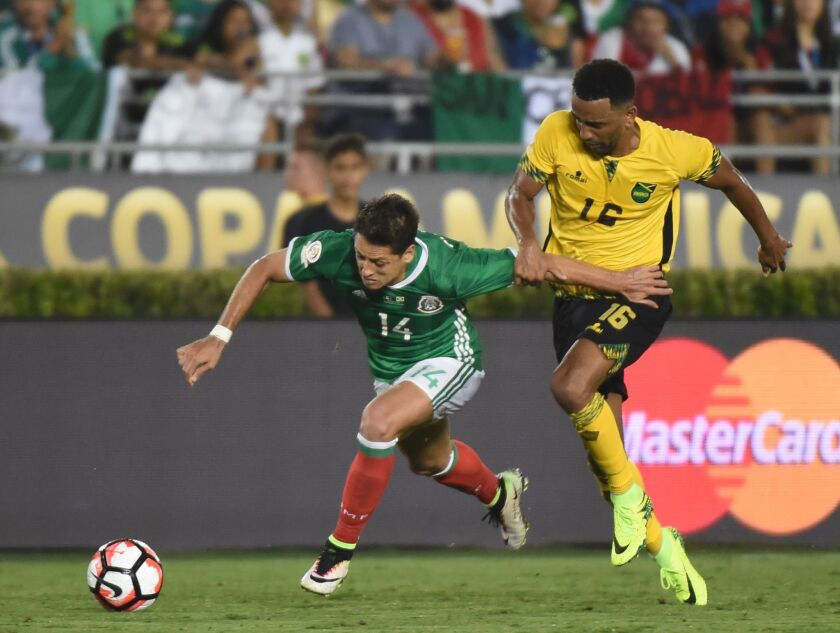 Mexico's Javier 'Chicharito' Hernandez (L) is marked by Jamaica's Lee Williamson during the Copa America Centenario football tournament in Pasadena, California, United States, on June 9, 2016. / AFP PHOTO / Mark RalstonMARK RALSTON/AFP/Getty Images ** OUTS - ELSENT, FPG, CM - OUTS * NM, PH, VA if sourced by CT, LA or MoD **