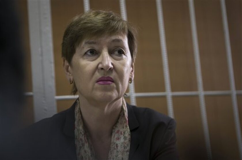 Nataliya Magnitskaya, the mother of lawyer Sergei Magnitsky whose death in Moscow's Butyrka prison sparked an international outcry, is seen at the Tverskoy court in Moscow, Tuesday, Oct. 2, 2012. The mother of a whistle-blowing Russian lawyer is calling for a new inquiry into his death. Natalya Magnitskaya, whose son Sergei Magnitsky died in jail of untreated pancreatitis in 2009, demanded prosecutors file new charges against several Russian officials while testifying against former prison doctor Dmitry Kratov Tuesday. Kratov denies charges of negligent homicide, citing a staff shortage. (AP Photo/ Alexander Zemlianichenko)