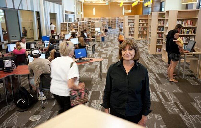 """Pam Sandlian-Smith, director of the Rangeview, Colo., Library District, says, """"It's very common for people to say, 'Why do I need a library when I've got a computer?' We have to reframe what the library means to the community."""""""