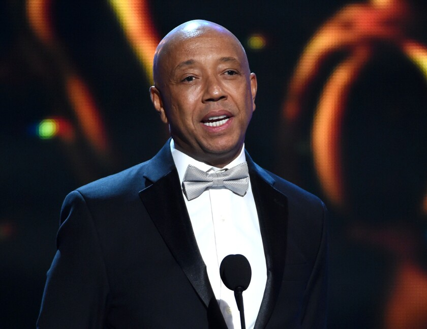 Russell Simmons appears on stage earlier this year at the NAACP Image Awards in Pasadena. Thousands of holders of prepaid debit cards he promoted have spent more than a week without access to their funds.