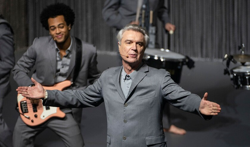 """This image released by the Toronto Film Festival shows David Byrne in a scene from """"David Byrne's American Utopia,"""" a documentary of Byrne's concert musical, directed by Spike Lee. The film opened the Toronto Film Festival on Thursday, Sept. 10. (Toronto Film Festival via AP)"""