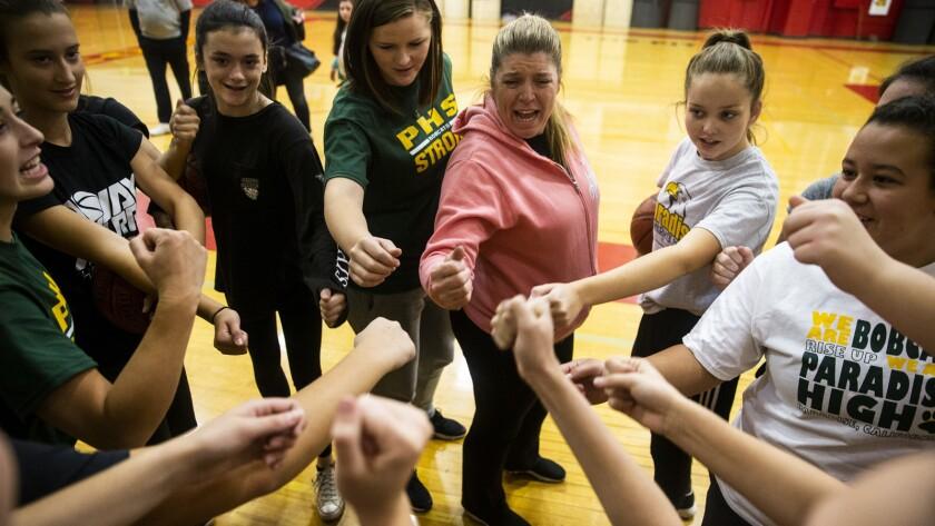 CHICO, CALIF. - NOVEMBER 15: Coach Sheila Craft and the Paradise High School Bobcats perform a team