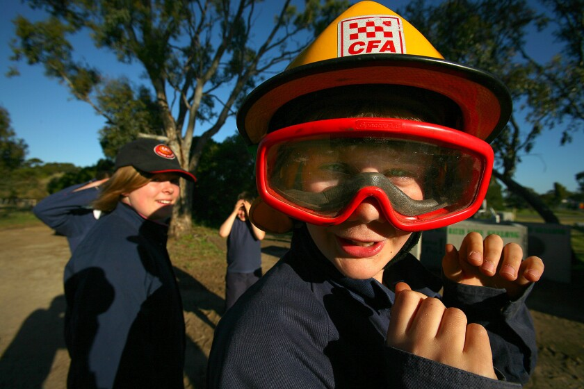"""Liam Hodges, a 12-year-old """"junior firey,"""" receives training from the County Fire Authority in Anakie, Australia."""