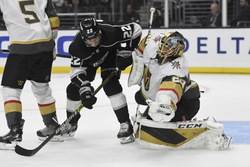 Vegas Golden Knights goalie Marc-Andre Fleury makes a save as Los Angeles Kings center Trevor Lewis (22) pressures during the second period of an NHL hockey game, Sunday, Oct. 13, 2019, in Los Angeles. (AP Photo/Michael Owen Baker)