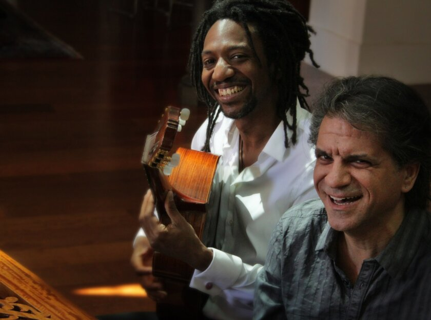 Cuban pianist Elio Villafranca, left, and Greek guitarist Spiros Exaras playfully swapped instruments for this photo.