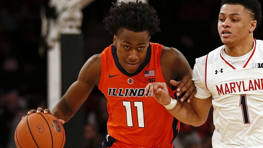 Illinois guard Ayo Dosunmu (11) brings the ball up court in front of Maryland guard Anthony Cowan Jr