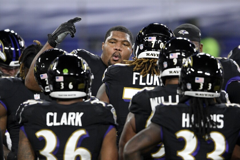 Baltimore Ravens defensive end Calais Campbell, center, leads a huddle with teammates after working out prior to an NFL football game against the Dallas Cowboys, Tuesday, Dec. 8, 2020, in Baltimore. (AP Photo/Nick Wass)