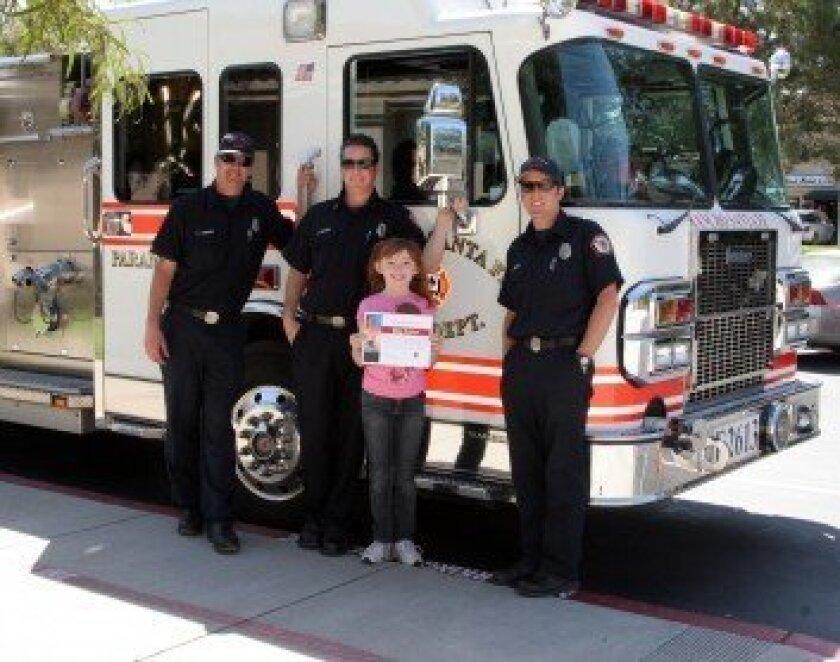 (Above) From left to right: Engineer Paul Lorenzo, Captain Jim Tenger, Riley Sullivan and Firefighter/Paramedic Joe Carter. Photos/Lisa Sullivan