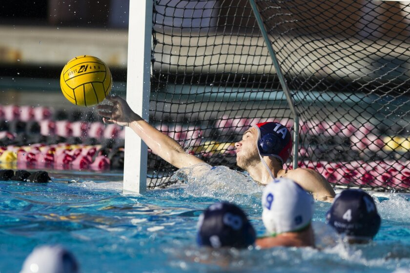 San Marcos' Dylan Hurd, who took over goalie duties late in the season, knocks a shot away for one of his 20 saves in the Knights' win over Eastlake on Saturday for the Division II title.