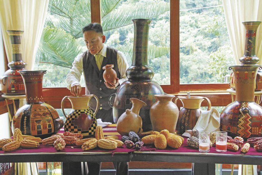 An employee of the Sumaq Machu Picchu Hotel gives a lesson and sampling of pink chicha, a fermented corn drink the Incas also enjoyed.