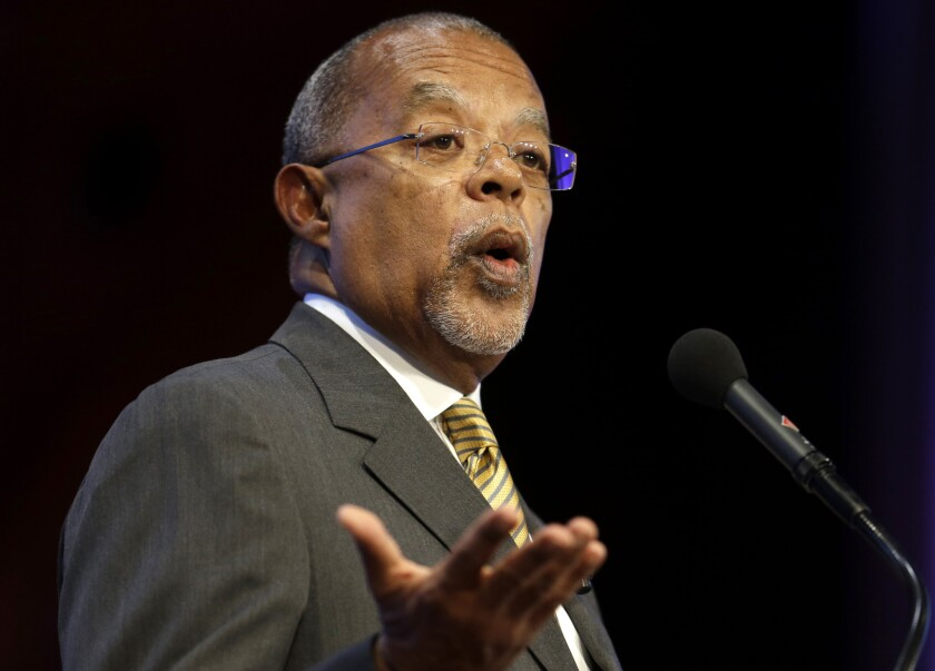 "Harvard professor Henry Louis Gates Jr. speaks during an award ceremony for the W.E.B. Du Bois Medal in 2013 in Cambridge, Mass. A ""Finding Your Roots"" episode that omitted references to Ben Affleck's ancestor as a slave owner violated PBS standards, the public TV service said Wednesday, June 24, 2015. Gates, the series host and executive producer, apologized for forcing PBS to defend the integrity of its programming. He said he's working with public TV on new guidelines to ensure increased transparency."
