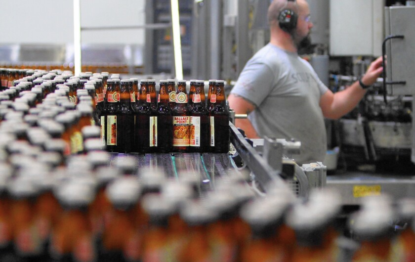 Sculpin, Ballast Point's pricey IPA, accounts for more than 50% of the brewery's revenue. Above, its production line in San Diego.