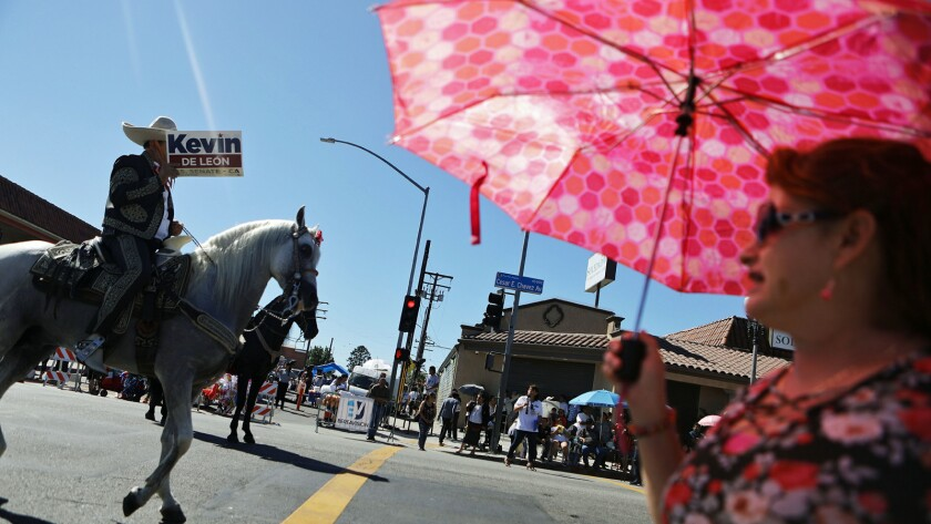 A rider carries a sign for U.S. Senate candidate Kevin de León during the East L.A. Mexican Independence Day parade in September.