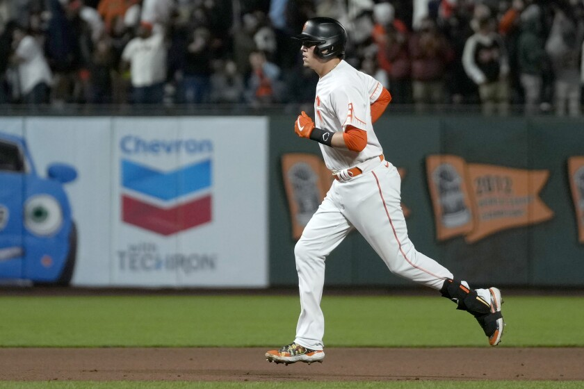 San Francisco Giants' Wilmer Flores runs the bases after hitting a solo home run against the Washington Nationals during the seventh inning of a baseball game Friday, July 9, 2021, in San Francisco. (AP Photo/Tony Avelar)