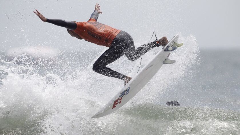 Kelly Slater launches a 360 during heat 12 the US Open of Surfing men's round of 96 on Tuesday, Aug.