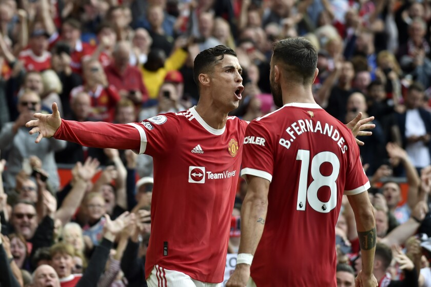 Manchester United's Cristiano Ronaldo celebrates after scoring the opening goal during the English Premier League soccer match between Manchester United and Newcastle United at Old Trafford stadium in Manchester, England, Saturday, Sept. 11, 2021. (AP Photo/Rui Vieira)