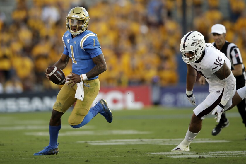 UCLA quarterback Dorian Thompson-Robinson scrambles during the first half against Arizona State on Oct. 26.
