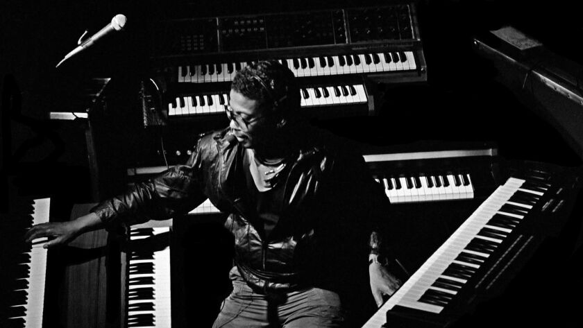 Herbie Hancock is surrounded by electric keyboards in this 1984 shot.