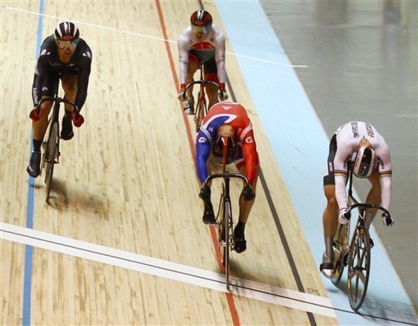 Britain's Chris Hoy, second right, beats out Germany's Maximilian Levy, right, to win the men's keirin at the Track Cycling World Championships in Melbourne, Australia, Sunday, April 8, 2012. (AP Photo/Rick Rycroft)