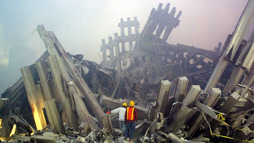 Rescue workers survey the ruins of the World Trade Center in New York in 2001.