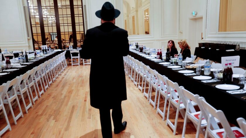A Rabbi prepares for a Passover seder in the ballroom of the Alexandria Hotel in Los Angeles on April 3, 2015.