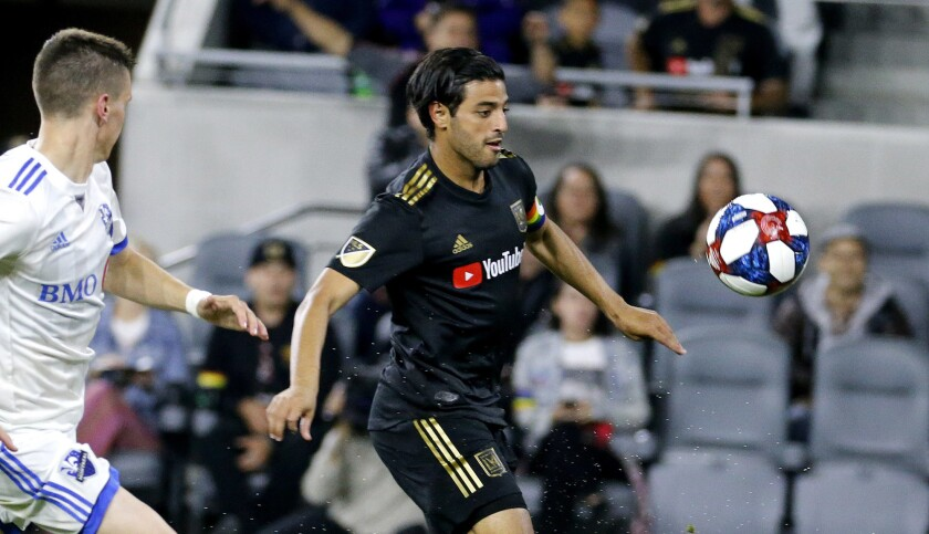 Los Angeles FC forward Carlos Vela (10) of Mexico, controls the ball in an MLS soccer match between