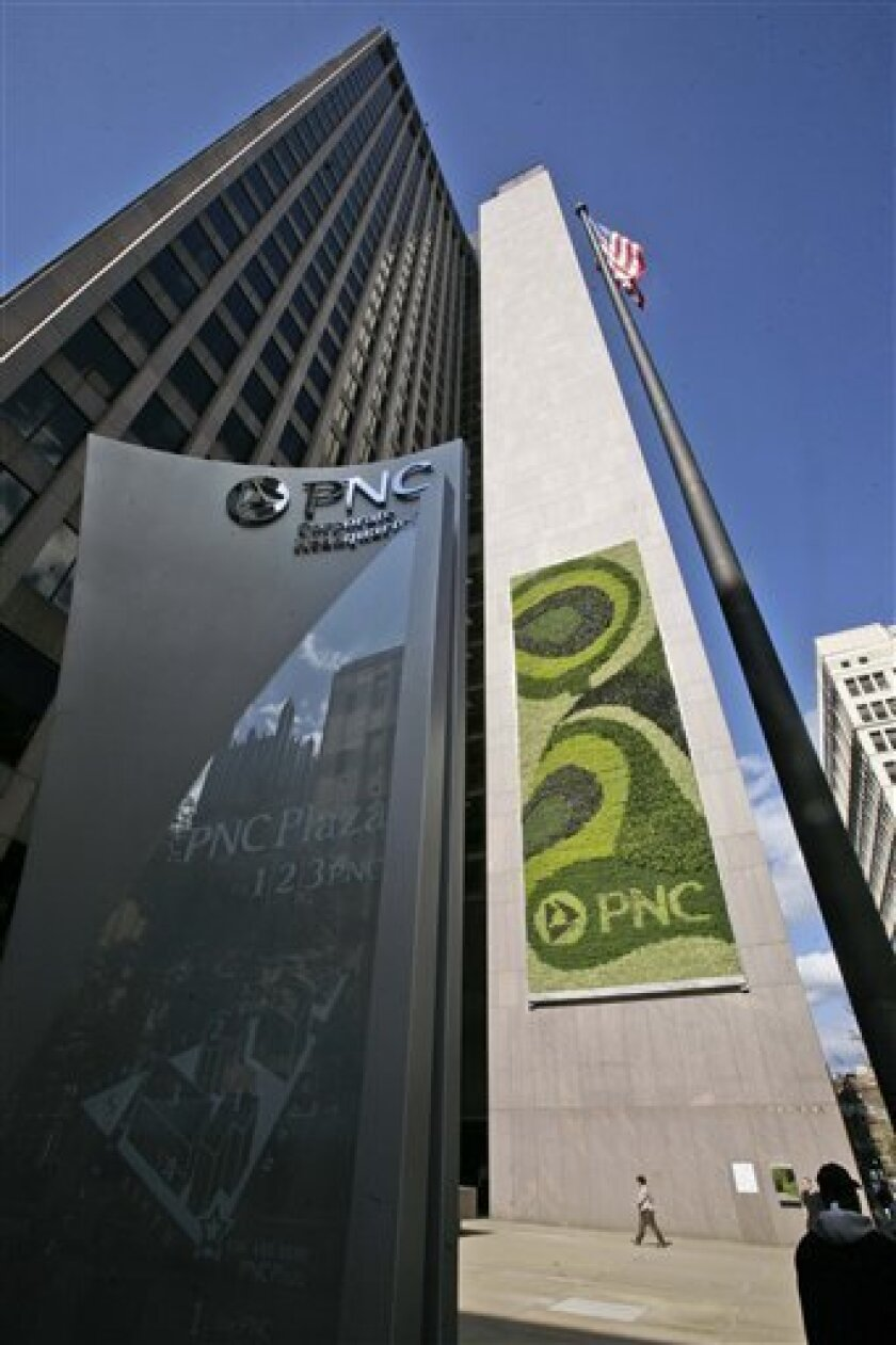 """In this photo taken Monday, Oct. 5, 2009, is a 2,380 square-foot-""""green wall"""", right, installed recently at One PNC Plaza, an office, hotel and condominium project in downtown Pittsburgh. Consisting of ferns, sedum, brass button and other plants, green walls boast the environmental benefits of removing air pollutants , and providing insulation. (AP Photo/Gene J. Puskar)"""
