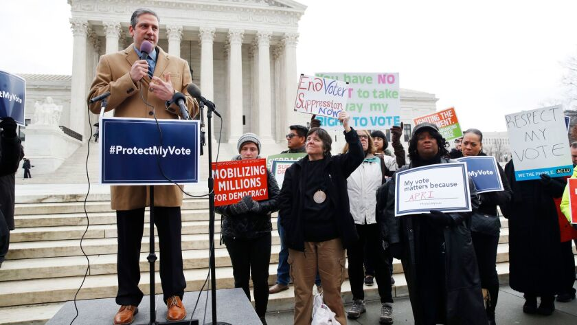 Rep. Tim Ryan (D-Ohio) speaks at a rally outside the Supreme Court on Wednesday, protesting Ohio's purges of voter rolls.