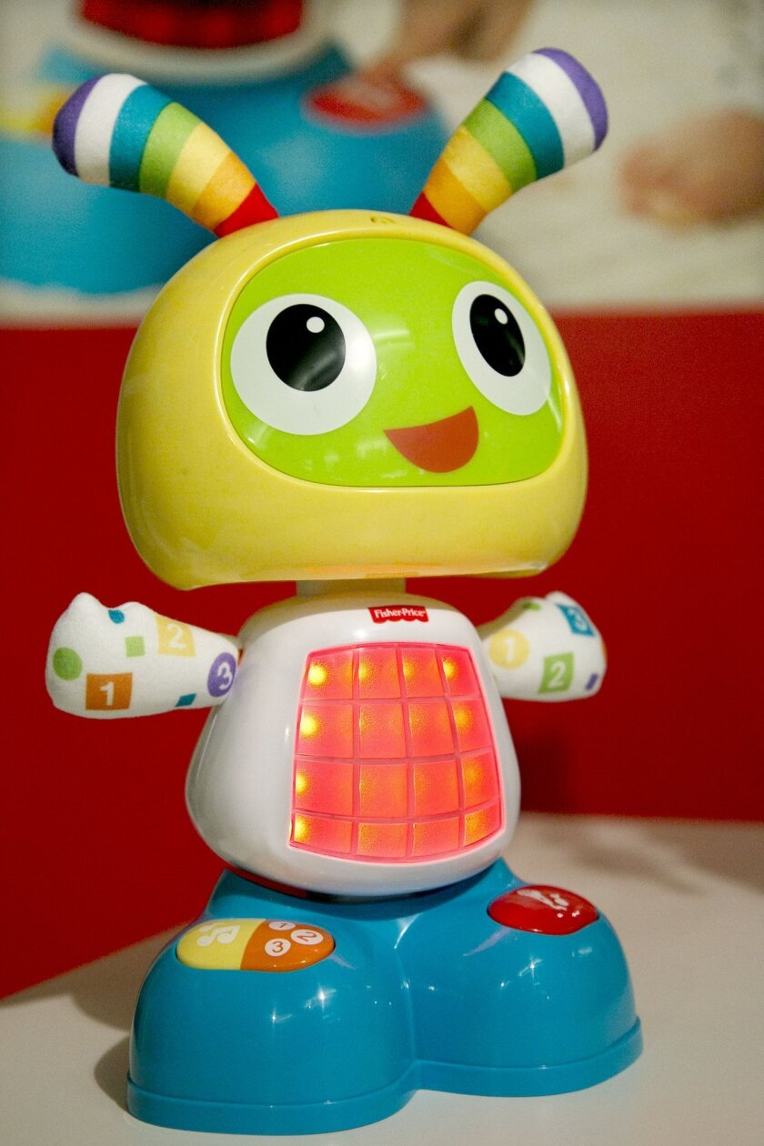 "In this Sept. 29, 2015, photo, a Bright Beats Dance & Move BeatBo from Fisher-Price is displayed at the TTPM Holiday Showcase in New York. Holiday toys hit the shelves in recent weeks. And so far, just as in the past few years, there's no single hot toy emerging. But anything ""Star Wars,"" life-like robotic pets and remote controlled toys should drive sales. (AP Photo/Mark Lennihan)"