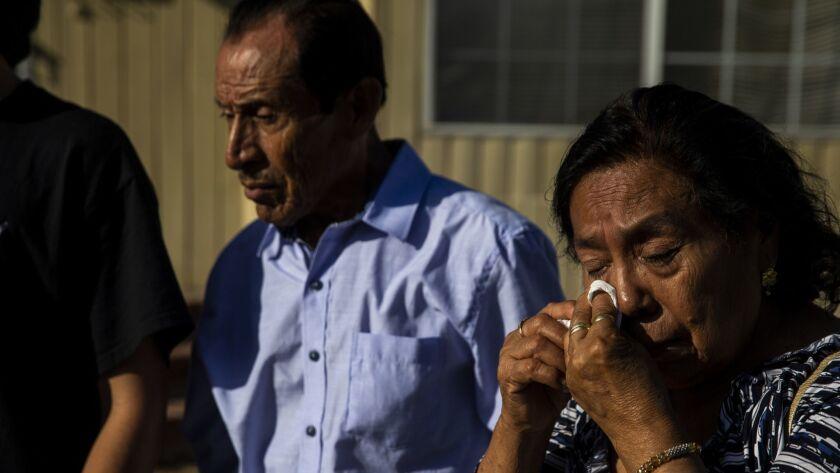 AZUSA, CALIF. - SEPTEMBER 19: Crus Cuevas, mother of Fabian Rebolledo, wipes away tears as her son s