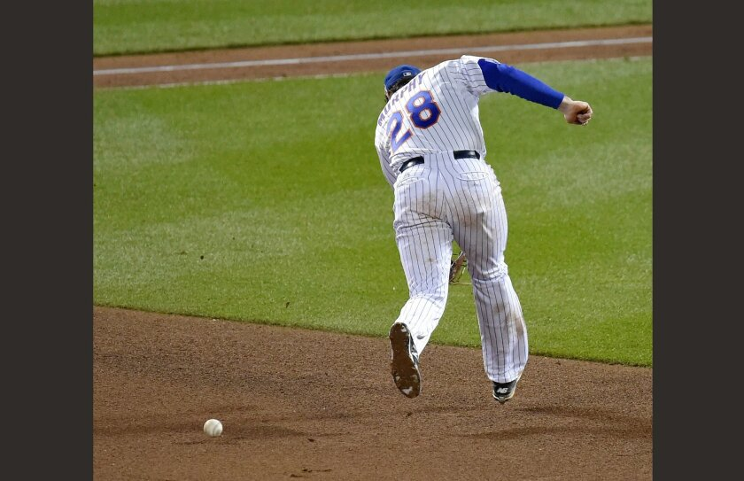 New York Mets second baseman Daniel Murphy misses a ball hit by Kansas City Royals' Eric Hosmer, resulting in an error during the eighth inning in Game 4 of the baseball World Series on Saturday, Oct. 31, 2015, in New York. (David Eulitt/The Kansas City Star via AP)
