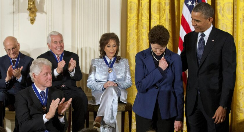 Tam O'Shaughnessy, the partner of the late Sally Ride, accepts the Presidential Medal of Freedom in Ride's honor Wednesday during a ceremony at the White House.
