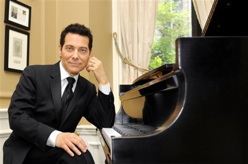 FILE - In this Aug. 26, 2009 file photo, pianist and vocalist Michael Feinstein poses for a photograph in New York. (AP Photo/Stephen Chernin, file)