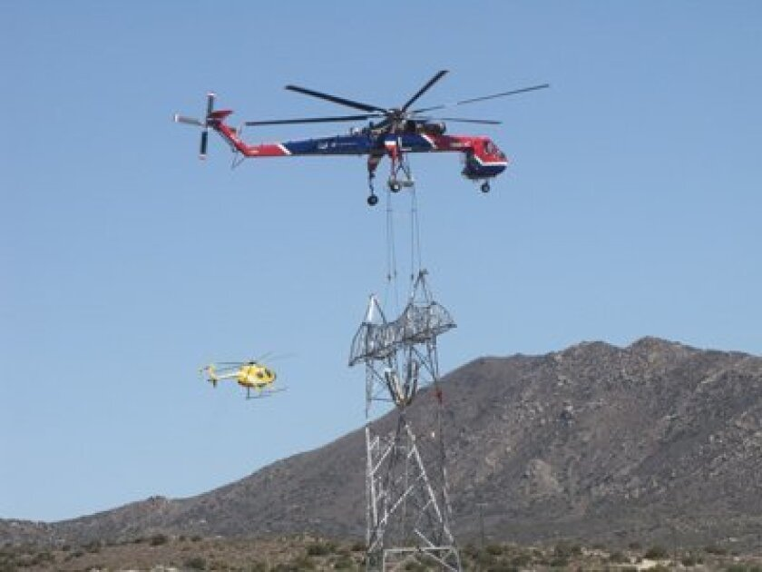 A helicopter transports a section for the Sunrise Powerlink transmission line. Credit: San Diego Gas and Electric
