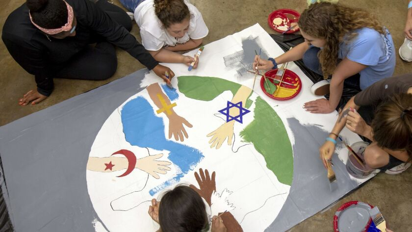 Forty-six Israeli, Palestinian and American teens teamed up to paint peace-themed murals the New Vil